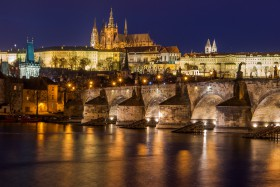 Prague Castle above Charles Bridge and the Moldau reflecting light